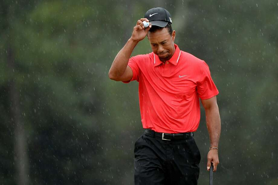 Tiger Woods found that when it rains it pours - and that includes his putting problems in the  final round at Augusta. Photo: Harry How, Getty Images