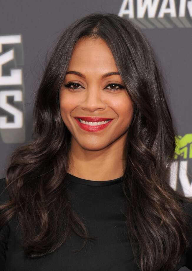 Zoe Saldana arrives at the MTV Movie Awards in Sony Pictures Studio Lot in Culver City, Calif., on Sunday April 14, 2013. (Photo by Jordan Strauss/Invision/AP)