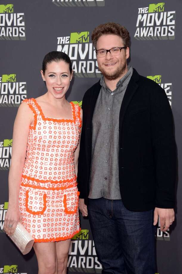 CULVER CITY, CA - APRIL 14:  Actor Seth Rogen (R) and wife Lauren Miller arrive at the 2013 MTV Movie Awards at Sony Pictures Studios on April 14, 2013 in Culver City, California.  (Photo by Jason Merritt/Getty Images)