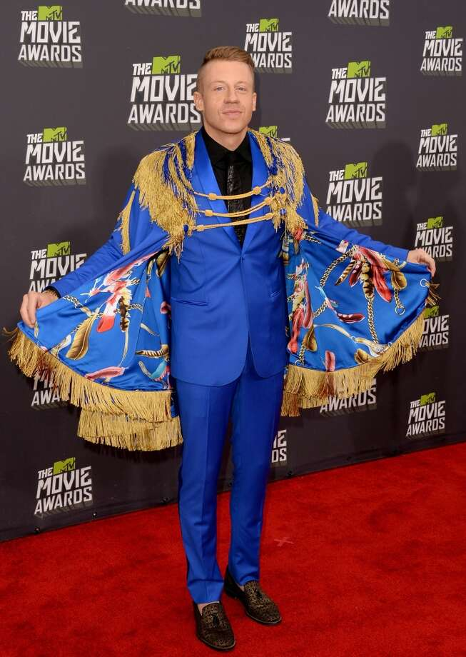 CULVER CITY, CA - APRIL 14:  Recording artist Macklemore arrives at the 2013 MTV Movie Awards at Sony Pictures Studios on April 14, 2013 in Culver City, California.  (Photo by Jason Merritt/Getty Images)