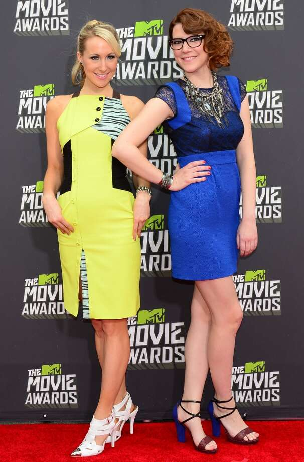 Comedians Nikki Glaser (L) and Sara Schaefer pose on arrival for the 2013 MTV Movie Awards in Los Angeles, California, on April 14, 2013.   AFP PHOTO/Frederic J. BROWNFREDERIC J. BROWN/AFP/Getty Images