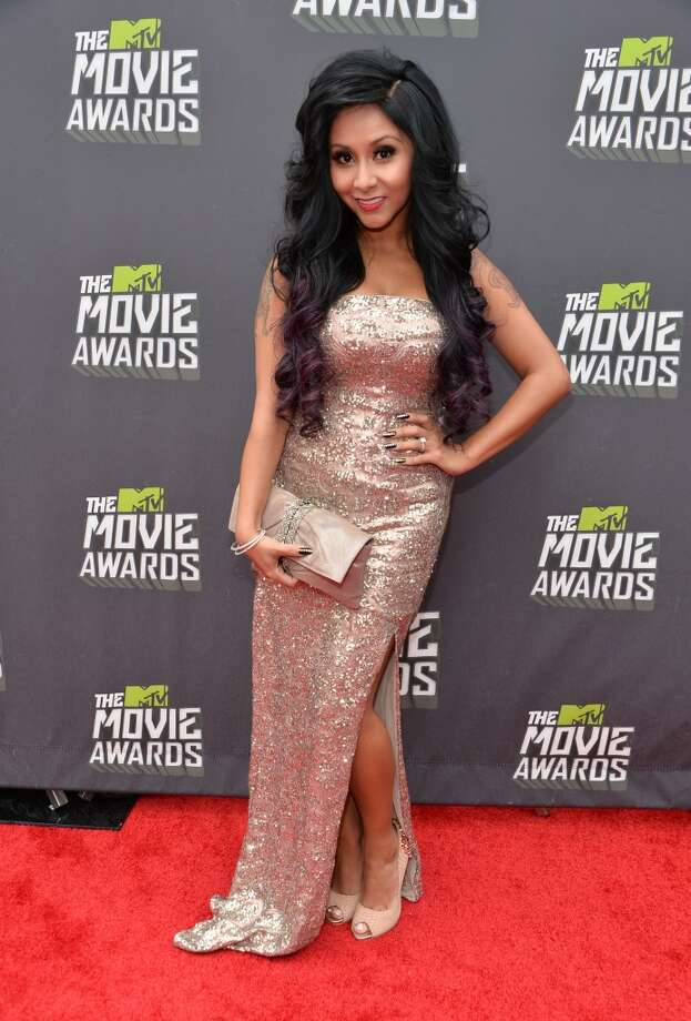 "CULVER CITY, CA - APRIL 14:  TV personality Nicole ""Snooki\""\' Polizzi arrives at the 2013 MTV Movie Awards at Sony Pictures Studios on April 14, 2013 in Culver City, California.  (Photo by Alberto E. Rodriguez/Getty Images)"