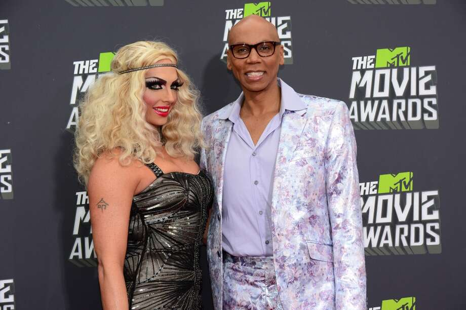 RuPaul and guest pose on arrival for the 2013 MTV Movie Awards in Los Angeles, California, on April 14, 2013.     AFP PHOTO/Frederic J. BROWNFREDERIC J. BROWN/AFP/Getty Images