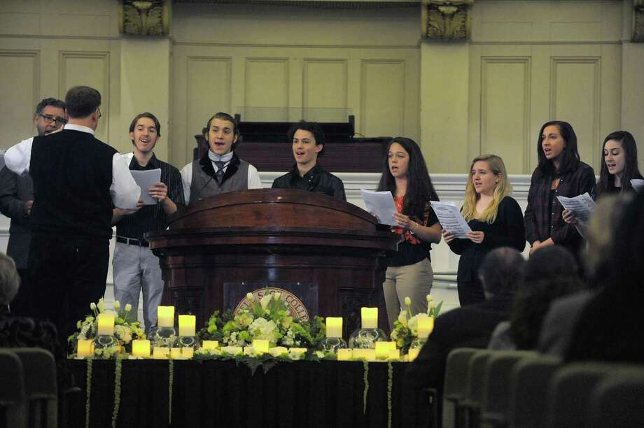 "Members of the Sage Chamber Choir perform the song ""Prayer of the Children""  during a memorial service to honor Sandy Hook principal Dawn Lafferty Hochsprung at  Russell Sage College on Sunday, April 14, 2013 in Troy, NY.  (Paul Buckowski / Times Union) Photo: Paul Buckowski"