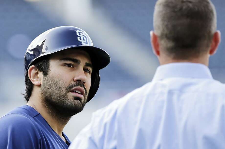 Carlos Quentin (left) made a point of noting that the Dodgers will still see plenty of him this season. Photo: Lenny Ignelzi, Associated Press