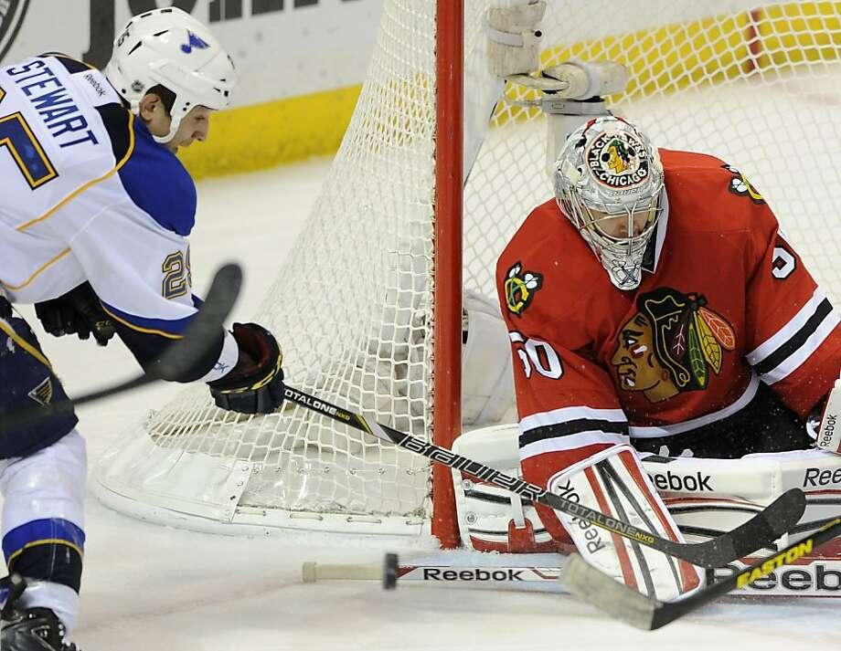 Blackhawks goalie Corey Crawford turns away Blues' Chris Stewart on his way to a shutout. Photo: Bill Boyce, Associated Press