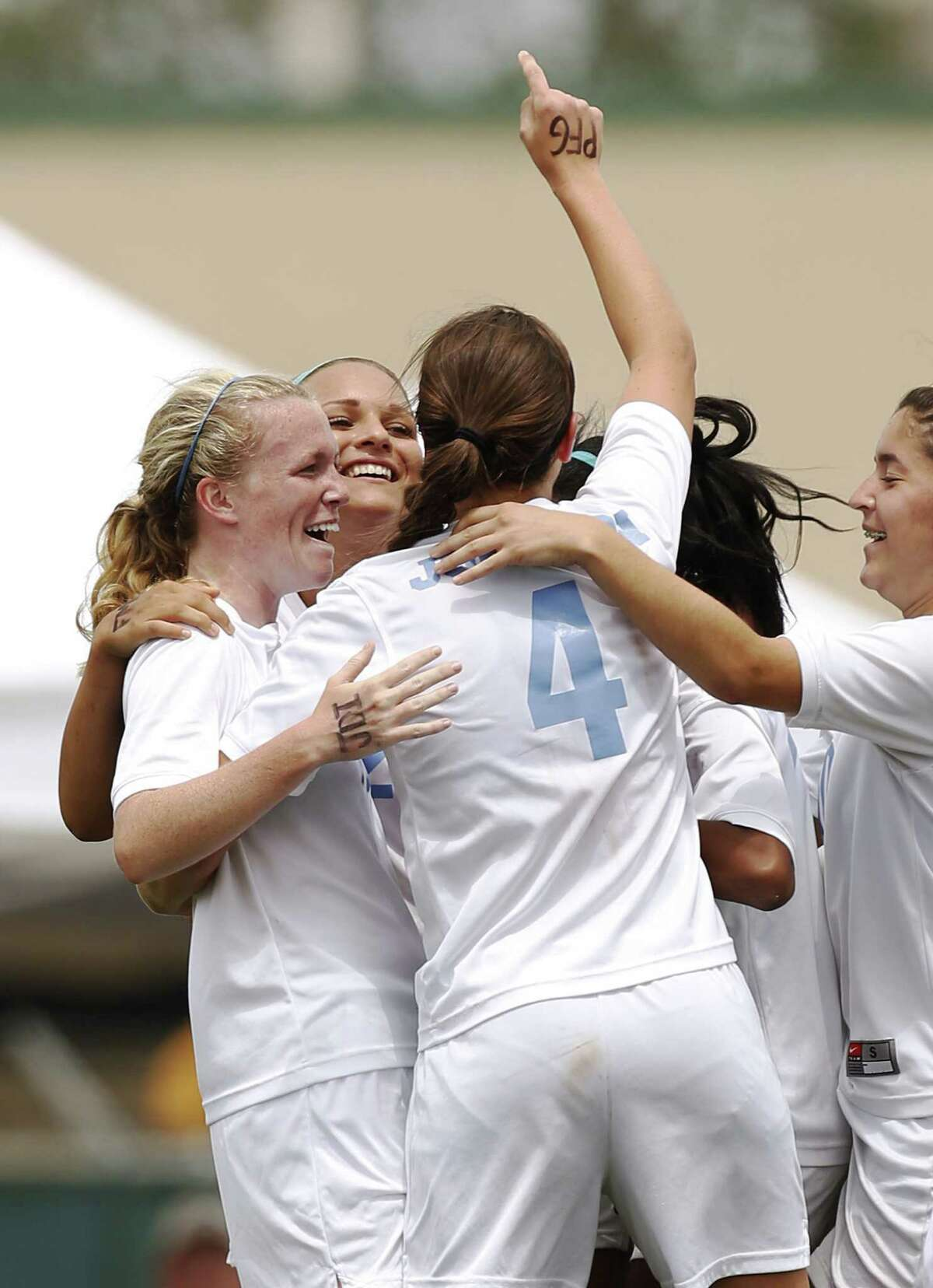 Johnson's players rejoice after Madelyn Carter's goal against Churchill in regulation during the Region IV-5A girls final on Saturday. The Jaguars went on to win 2-1 on penalty kicks.