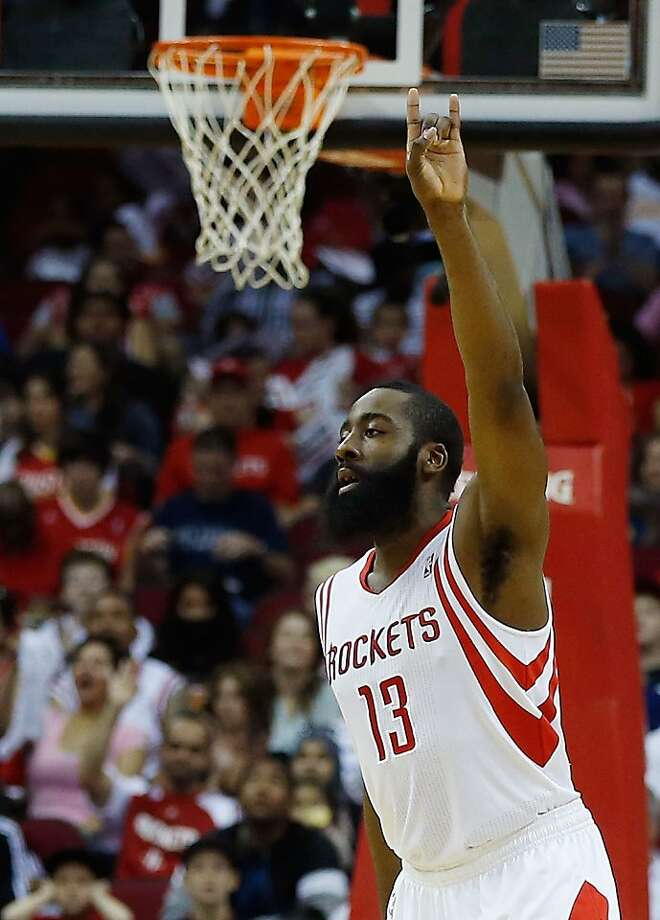 James Harden celebrates a three-point shot during the Rockets' 121-100 win over the Kings. Harden and the other starters rested during the fourth quarter. Photo: Scott Halleran, Getty Images
