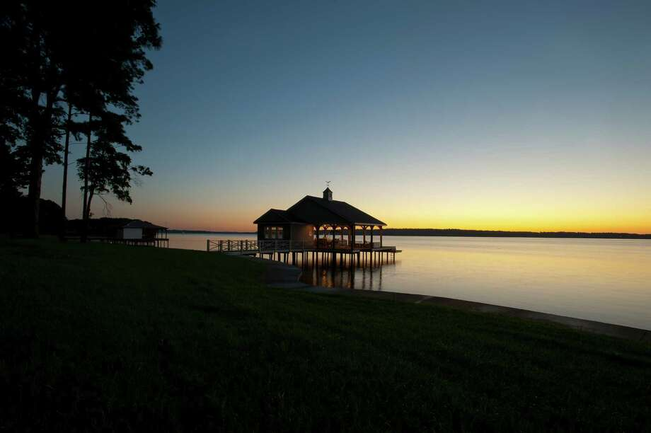"Lisa Wong: ""I've been thinking about taking my nephews and nieces on a boathouse vacation on one of our Texas lakes. I think it would be a lot of fun plus a lot of quality time with my little ones."" PHOTO: A boathouse on a still morning on Lake Palestine in east Texas. Photo: Dave Shafer, Aurora / Getty Images / Aurora Creative"