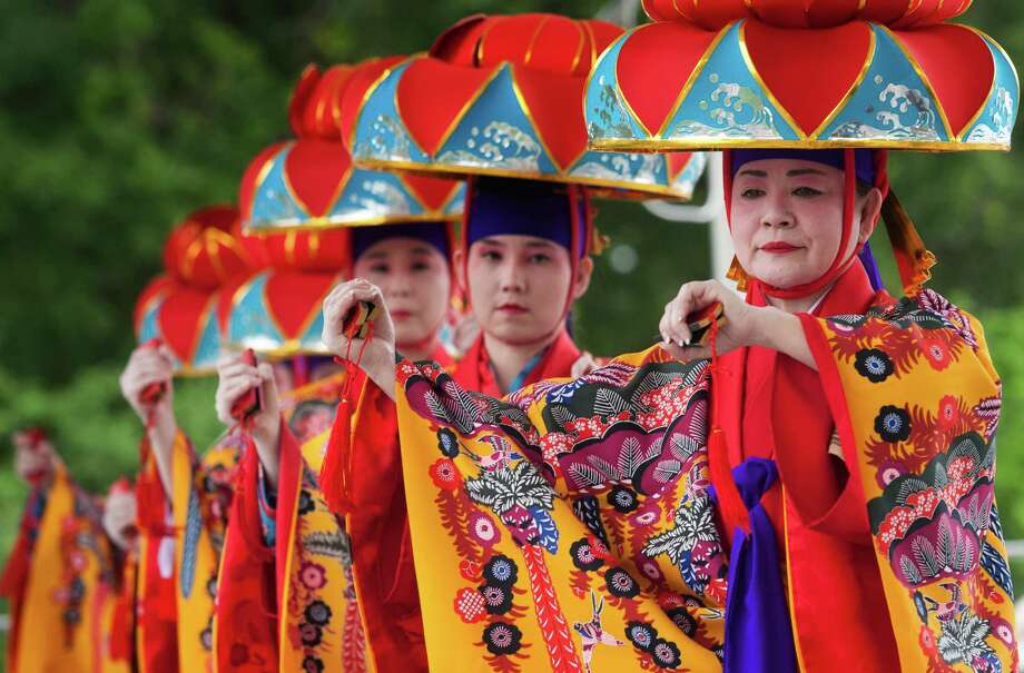 Michiko Gardner, right, Susan Cunningham, second from right, and the rest of the Miyagi Ryu Nosho Kai dance group perform an Okinawan dance during the 20th annual Japan Festival in Hermann Park on Sunday. Photo: J. Patric Schneider, Freelance / © 2013 Houston Chronicle