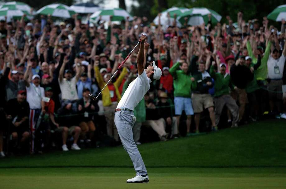Adam Scott, of Australia, celebrates after making a birdie putt on the second playoff hole to win the Masters golf tournament Sunday, April 14, 2013, in Augusta, Ga. (AP Photo/David J. Phillip) Photo: David J. Phillip / AP
