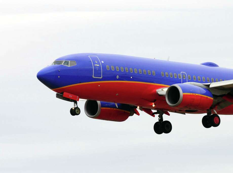 Southwest flight #3865 lands Thursday lunchtime, April 11, 2013, at Albany International Airport in Colonie , N.Y. A new study predicts that jet travel will be getting a lot bumpier in coming years, as man-made climate change drives increasing turbulence in the upper level atmosphere. (Will Waldron/Times Union) Photo: Will Waldron