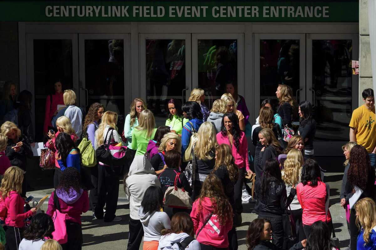 Waiting for the doors to open, over 180 hopeful women showed up for the first round of open Sea Gals auditions Sunday, April 14, 2013, at the CenturyLink Field Event Center in Seattle. Contestants were judged on dance ability, pizzazz and physical appearance. Nearly half of the attendees made the preliminary cut.