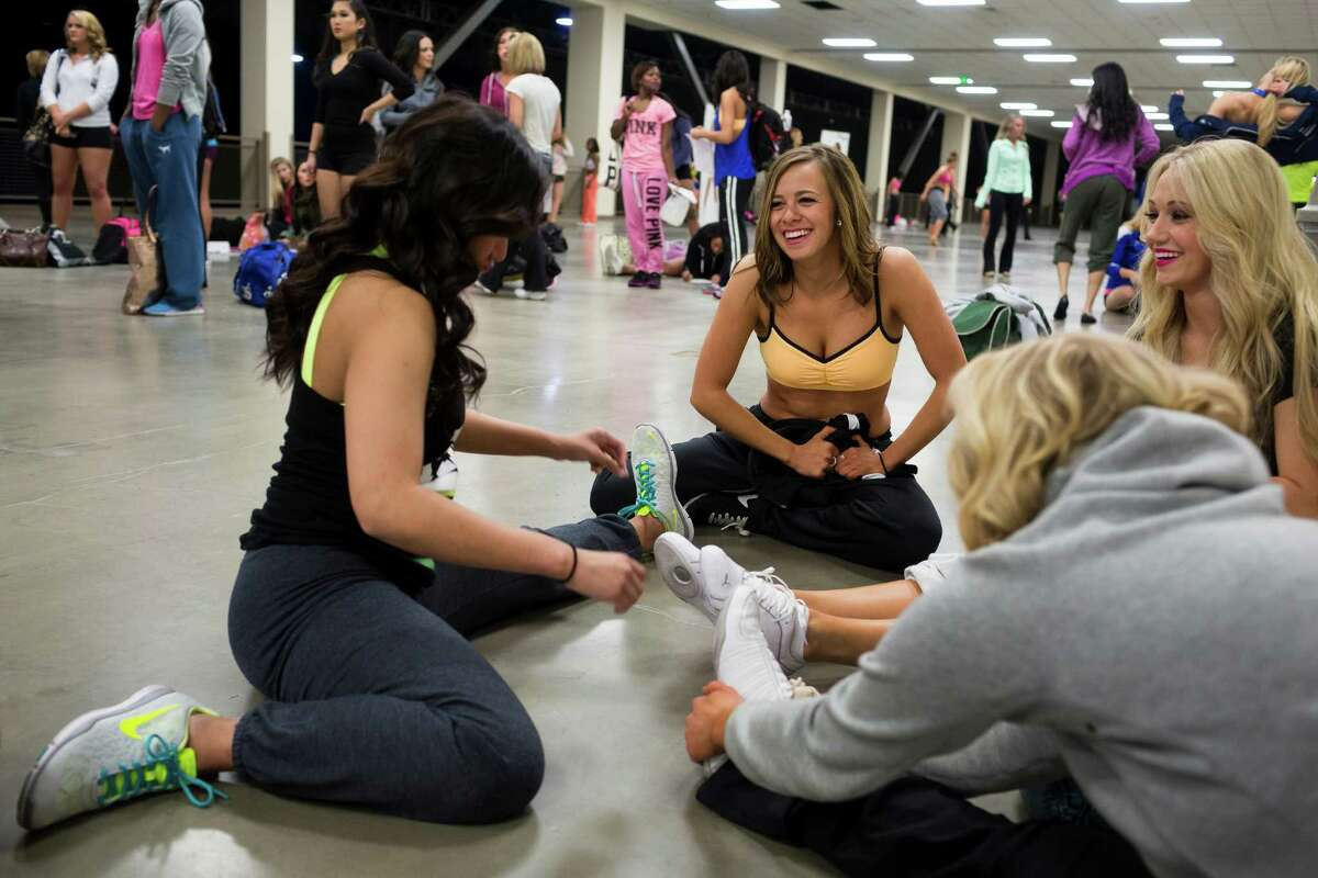 Lily Schauffle, 23, center right, laughs with a group of friends while stretching out before the first round of open Sea Gals auditions Sunday, April 14, 2013, at the CenturyLink Field Event Center in Seattle. Contestants were judged on dance ability, pizzazz and physical appearance. Nearly half of the attendees made the preliminary cut.