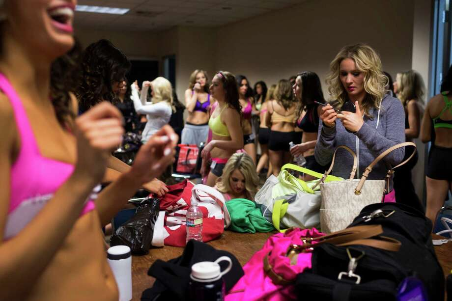 Women ditch bags and phones before the first round of open Sea Gals auditions Sunday, April 14, 2013, at the CenturyLink Field Event Center in Seattle. Contestants were judged on dance ability, pizzazz and physical appearance. Nearly half of the attendees made the preliminary cut. Photo: JORDAN STEAD / SEATTLEPI.COM