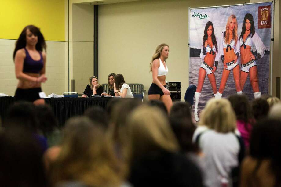 Judges deliberate during the first round of open Sea Gals auditions Sunday, April 14, 2013, at the CenturyLink Field Event Center in Seattle. Contestants were judged on dance ability, pizzazz and physical appearance. Nearly half of the attendees made the preliminary cut. Photo: JORDAN STEAD / SEATTLEPI.COM