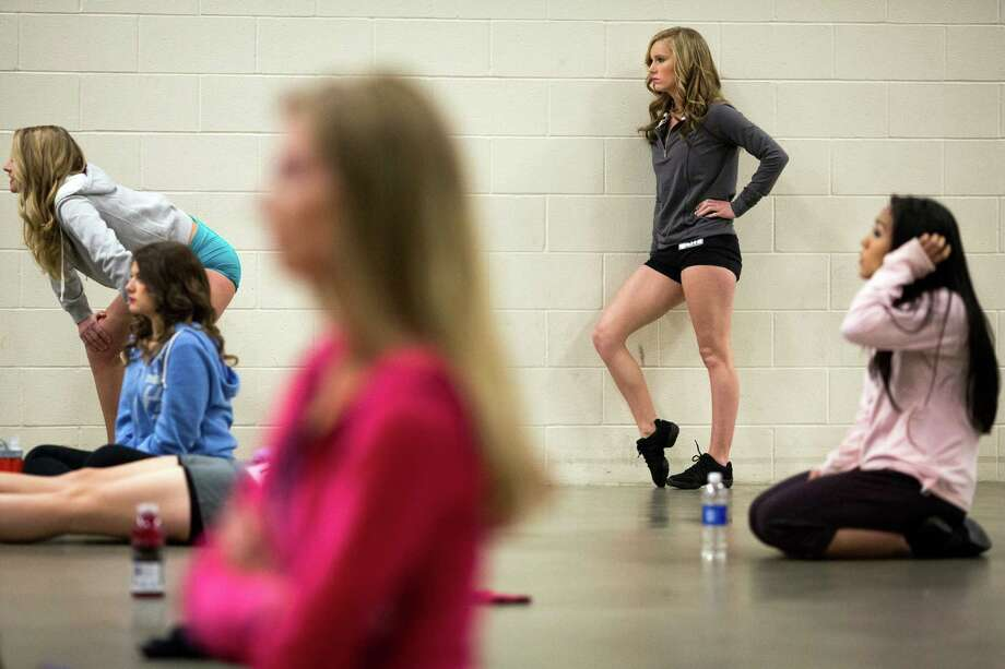 Women watch others perform during the first round of open Sea Gals auditions Sunday, April 14, 2013, at the CenturyLink Field Event Center in Seattle. Contestants were judged on dance ability, pizzazz and physical appearance. Nearly half of the attendees made the preliminary cut. Photo: JORDAN STEAD / SEATTLEPI.COM
