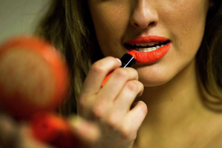 Makeup and lipstick is applied before the first round of open Sea Gals auditions Sunday, April 14, 2013, at the CenturyLink Field Event Center in Seattle. Contestants were judged on dance ability, pizzazz and physical appearance. Nearly half of the attendees made the preliminary cut. Photo: JORDAN STEAD / SEATTLEPI.COM