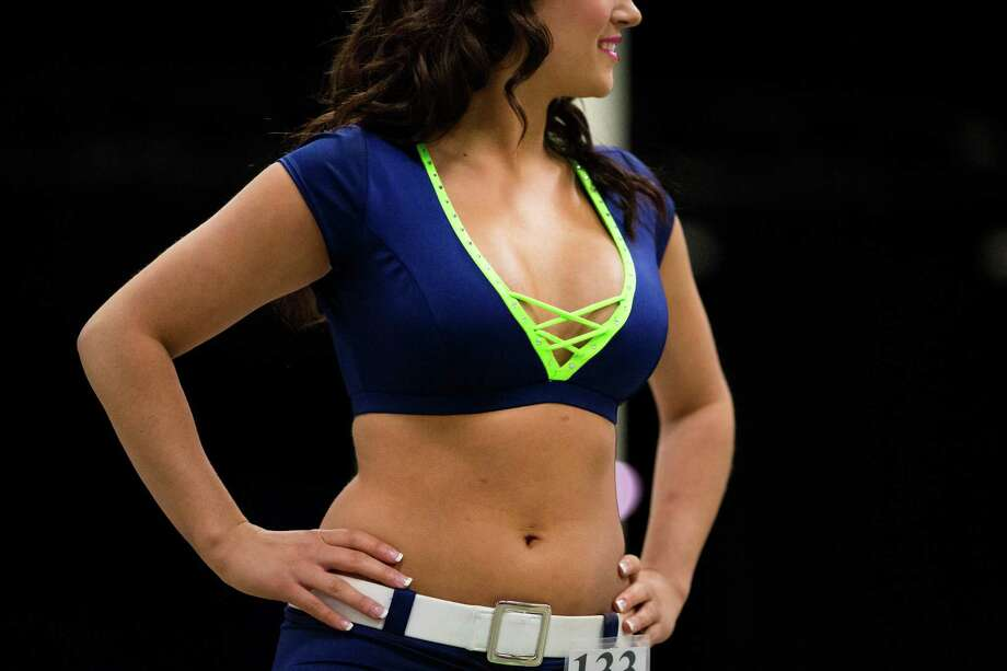 An attendee shows of her Seahawks colored outfit during the first round of open Sea Gals auditions Sunday, April 14, 2013, at the CenturyLink Field Event Center in Seattle. Contestants were judged on dance ability, pizzazz and physical appearance. Nearly half of the attendees made the preliminary cut. Photo: JORDAN STEAD / SEATTLEPI.COM