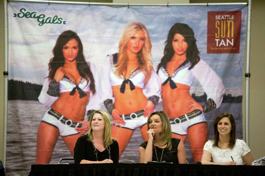 From left to right, judges Shannon Kingsley, Sherri Thompson and Lauren Mack watch girls perform during the first round of open Sea Gals auditions Sunday, April 14, 2013, at the CenturyLink Field Event Center in Seattle. Contestants were judged on dance ability, pizzazz and physical appearance. Nearly half of the attendees made the preliminary cut. Photo: JORDAN STEAD / SEATTLEPI.COM