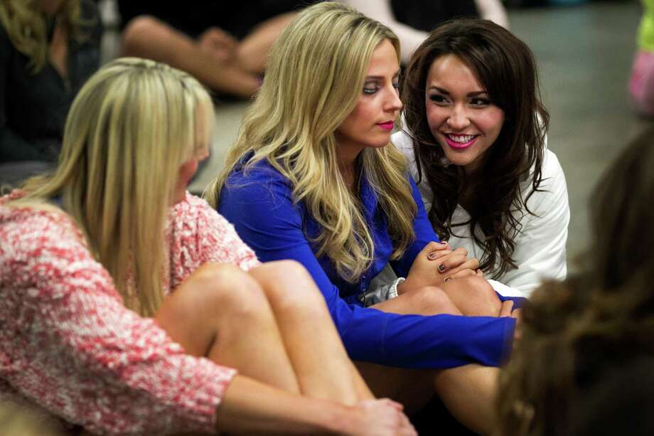 Women wish each other good luck following the first round of open Sea Gals auditions Sunday, April 14, 2013, at the CenturyLink Field Event Center in Seattle. Contestants were judged on dance ability, pizzazz and physical appearance. Nearly half of the attendees made the preliminary cut. Photo: JORDAN STEAD / SEATTLEPI.COM