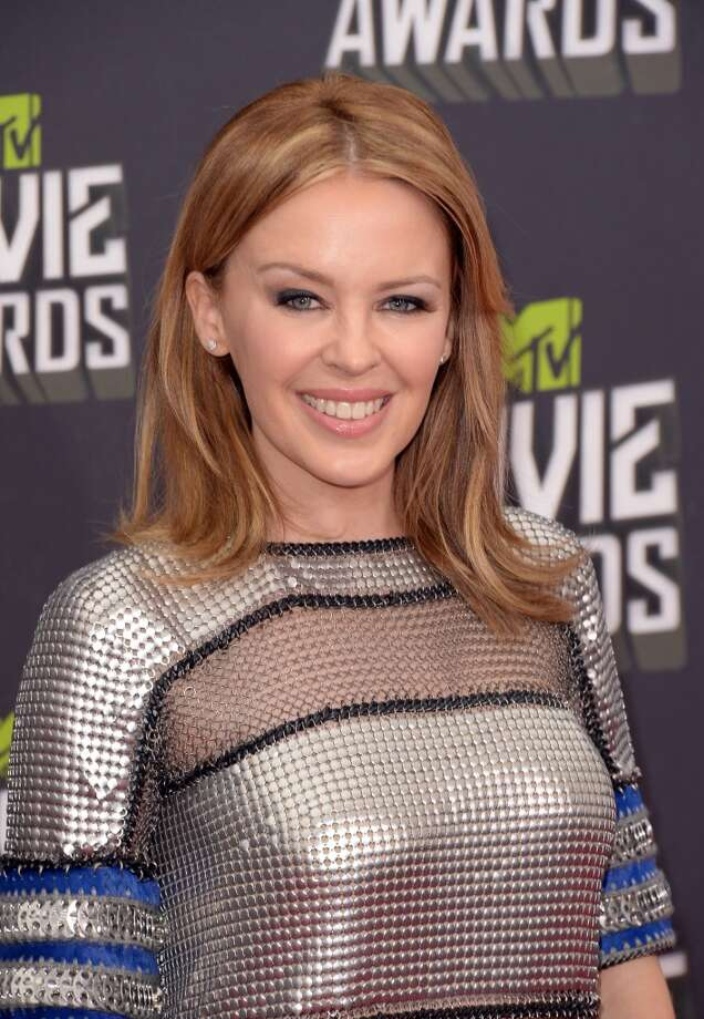 CULVER CITY, CA - APRIL 14:  Singer Kylie Minogue arrives at the 2013 MTV Movie Awards at Sony Pictures Studios on April 14, 2013 in Culver City, California.  (Photo by Jason Merritt/Getty Images)