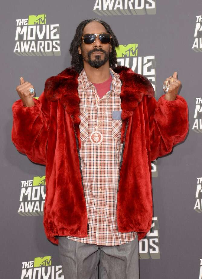 CULVER CITY, CA - APRIL 14:  Rapper Snoop Lion arrives at the 2013 MTV Movie Awards at Sony Pictures Studios on April 14, 2013 in Culver City, California.  (Photo by Jason Merritt/Getty Images)