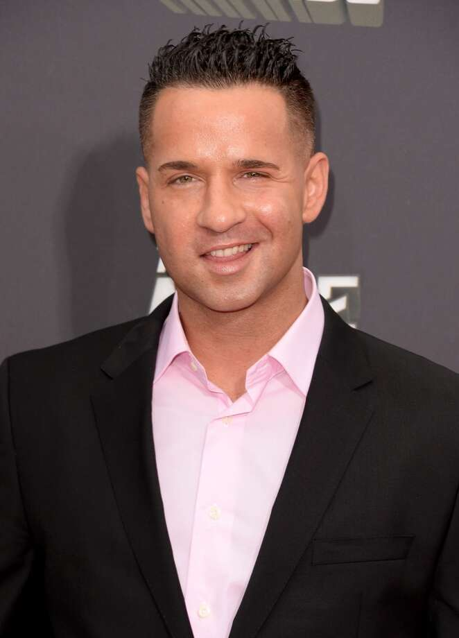 """TV personality Mike \""""The Situation\"""" Sorrentino arrives at the 2013 MTV Movie Awards at Sony Pictures Studios on April 14, 2013 in Culver City, California.  (Photo by Jason Merritt/Getty Images)"""