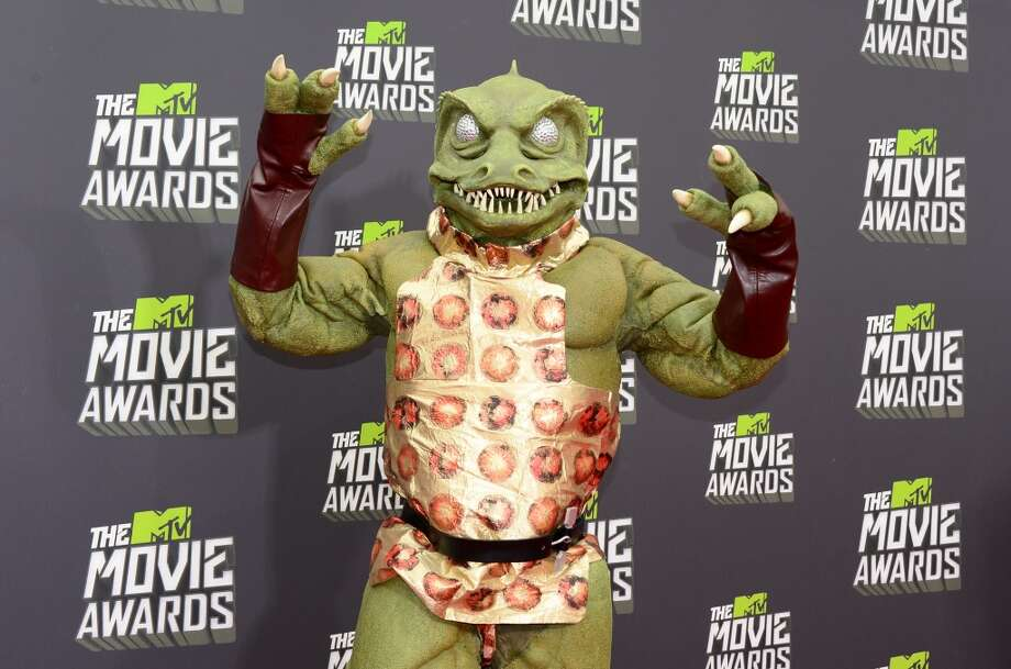 The Gorn, the lizard-like villain from Star Trek, poses on arrival for the 2013 MTV Movie Awards in Los Angeles, California, on April 14, 2013.    AFP PHOTO/Frederic J. BROWNFREDERIC J. BROWN/AFP/Getty Images
