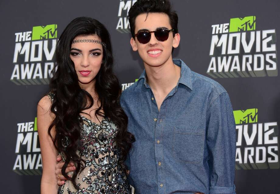 Brandon and Savannah pose on arrival for the 2013 MTV Movie Awards in Los Angeles, California, on April 14, 2013.   AFP PHOTO/Frederic J. BROWNFREDERIC J. BROWN/AFP/Getty Images