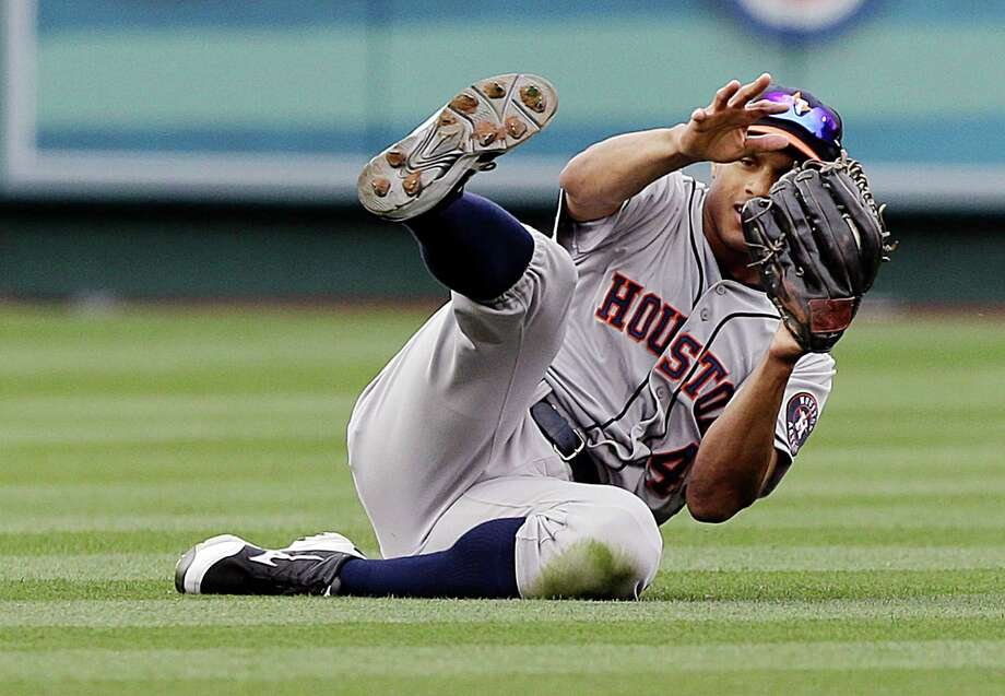 Astros center fielder Justin Maxwell takes a hit away from Albert Pujols in the fifth inning Sunday. Photo: Reed Saxon, STF / AP