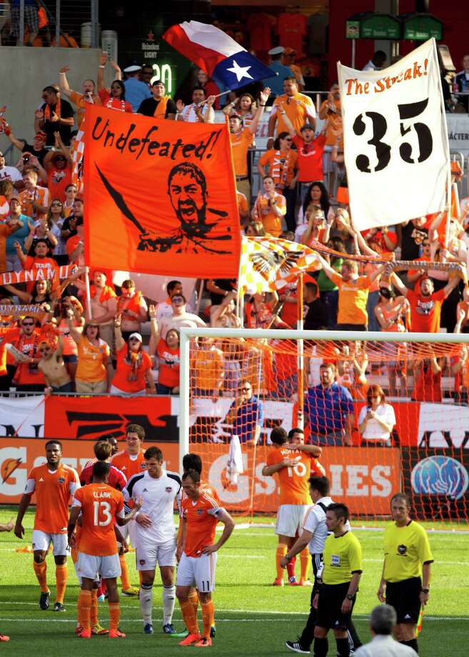 The crowd of 18,492 at BBVA Compass Stadium toasts the Dynamo for their 35th consecutive home match without a loss in all competitions. Photo: Brett Coomer, Staff / © 2013 Houston Chronicle