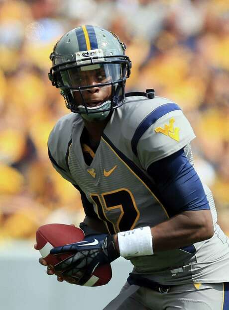 West Virginia's Geno Smith should be the first quarterback chosen in a class that has a tough act to follow after the Luck-Griffin-Wilson trio of 2012. Photo: Christopher Jackson, FRE / AP2012