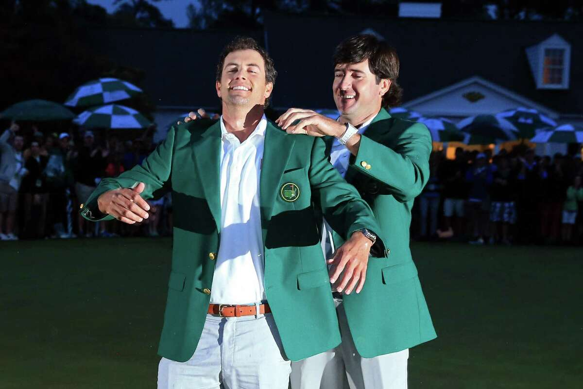 An Aussie rules at the Masters for the first time as Adam Scott, left, joins the exclusive fraternity Bubba Watson crashed in 2012.