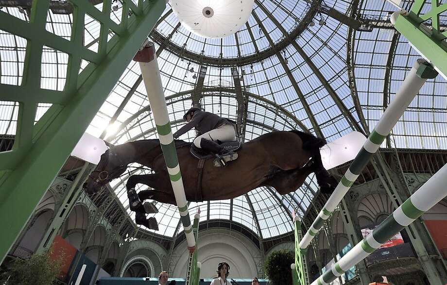 German rider Ludger Beerbaum on Chaman clears an obstacle on April 14, 2013 to win the jumping event of the Grand Prix Hermes of Paris at the Grand Palais in Paris.  AFP PHOTO / ERIC FEFERBERG.ERIC FEFERBERG/AFP/Getty Images Photo: Eric Feferberg, AFP/Getty Images
