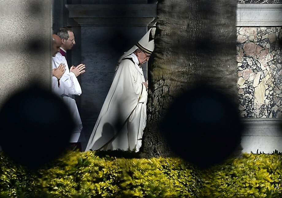 Pope Francis (R) arrives at the Basilica of Saint Paul Outside the Walls in Rome on April 14, 2013 to lead mass.  AFP PHOTO / Filippo MONTEFORTEFILIPPO MONTEFORTE/AFP/Getty Images Photo: Filippo Monteforte, AFP/Getty Images