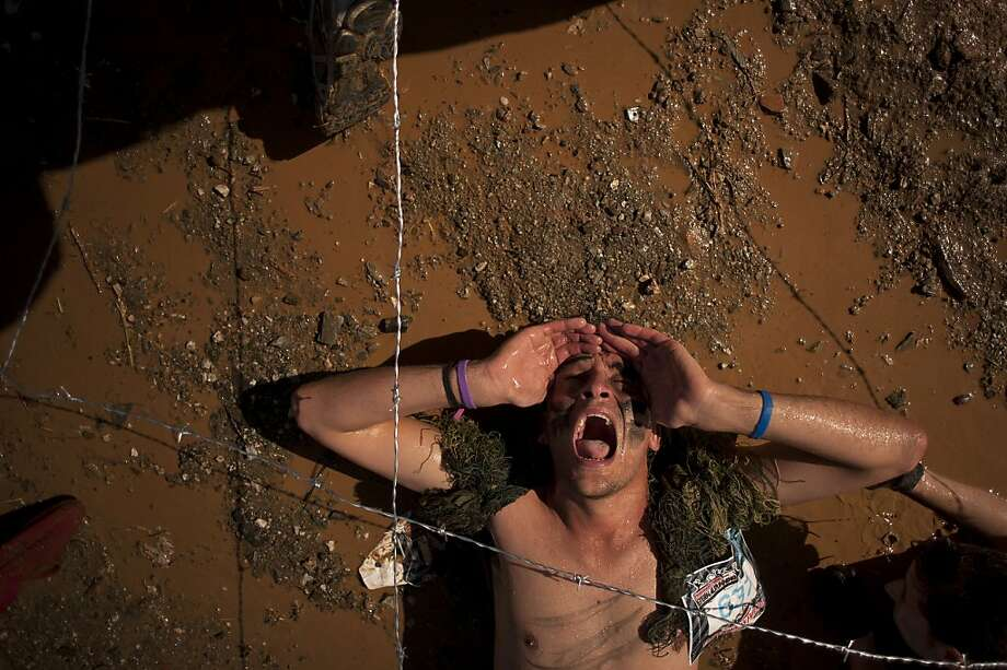 A participant competes during the Fisherman's friend Strongmanrun in Alozaina, near Malaga on April 14, 2013.  AFP PHOTO / JORGE GUERREROJorge Guerrero/AFP/Getty Images Photo: Jorge Guerrero, AFP/Getty Images