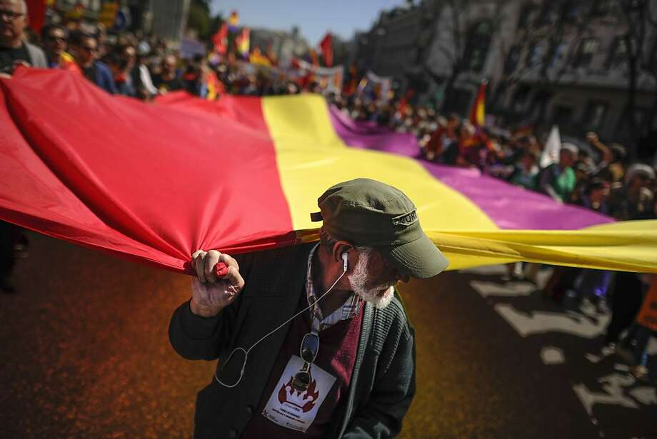 TOPSHOTS People hold a giant flag of Spain's second Republic during a demonstration by Republicans in Madrid, on April 14, 2013 to commemorate the 82nd anniversary of the Second Republic.  AFP PHOTO/   PEDRO ARMESTREPEDRO ARMESTRE/AFP/Getty Images Photo: Pedro Armestre, AFP/Getty Images