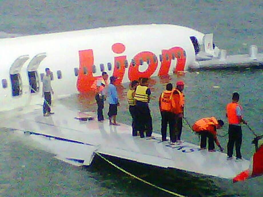 "This handout photo released by the Indonesian Search And Rescue Agency (SAR) on April 13, 2013 shows a Lion Air Boeing 737 lies submerged in the water after missing the runaway during landing at Bali's international airport near Denpasar. The Indonesian plane carrying more than 100 passengers broke in two after missing the runway at Bali airport on April 13 and landing in the sea, leaving dozens injured but no fatalities. AFP PHOTO/Indonesian Search And Rescue Agency (SAR)-----EDITORS NOTE---- RESTRICTED TO EDITORIAL USE - MANDATORY CREDIT ""AFP PHOTO / Indonesian Search And Rescue Agency  (SAR)"" - NO MARKETING NO ADVERTISING CAMPAIGNS - DISTRIBUTED AS A SERVICE TO CLIENTSSONNY TUMBELAKA/AFP/Getty Images Photo: Sonny Tumbelaka, AFP/Getty Images"