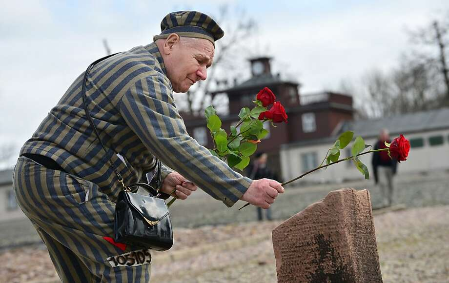 Petro Mischtschuk, a Ukrainian survivor of the Buchenwald concentration camp, lays flowers during a ceremony marking the 68th anniversary of the liberation of the Buchenwald Nazi concentration camp outside Weimar, eastern Germany, April 14, 2013. More than 50.000 prisoners -Jews, non-Jewish Poles and Slovenes, religious and political prisoners, Roma and Sinti, Jehovah's Witnesses, criminals, homosexuals, and prisoners of war- died in the camp between 1937 and 1945. AFP PHOTO / MARTIN SCHUTT GERMANY OUTMARTIN SCHUTT/AFP/Getty Images Photo: Martin Schutt, AFP/Getty Images