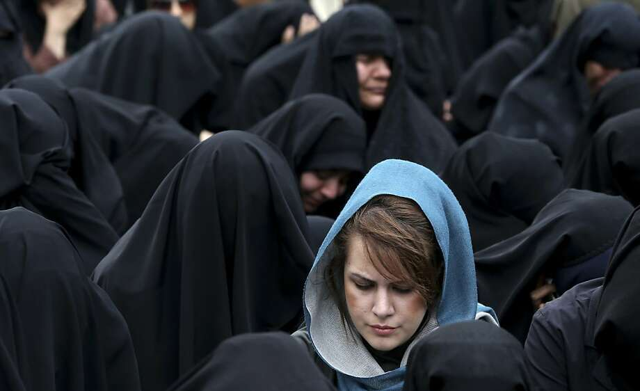 Rite of mourning:In Tehran, women remember Fatima, the daughter of Prophet Muhammad, on the anniversary of her death. Photo: Ebrahim Noroozi, Associated Press