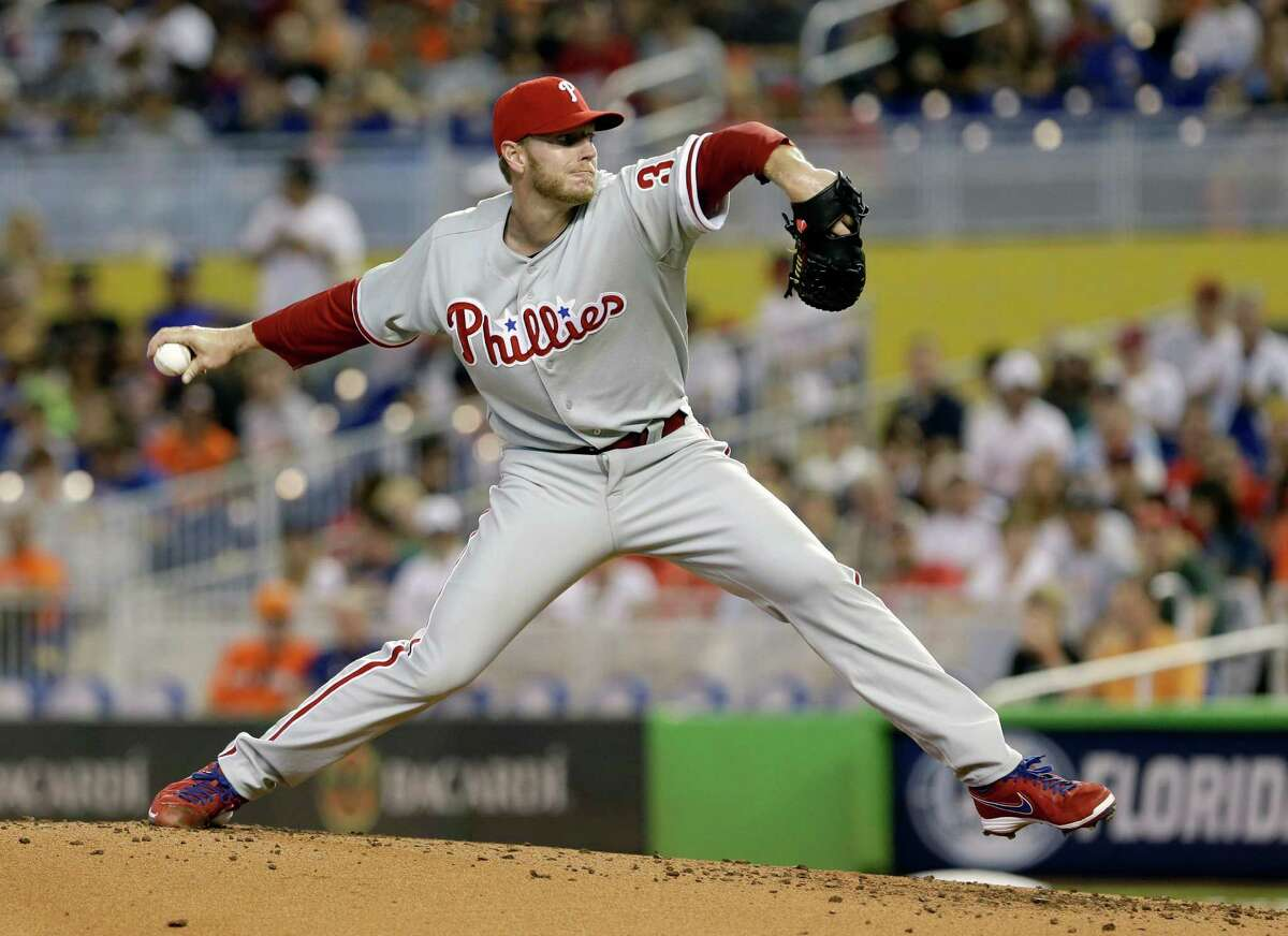 Roy Halladay joined Andy Pettitte (247 wins) as the majors' only active 200-game winners by beating the Marlins on Sunday. The Braves' Tim Hudson is at 199.