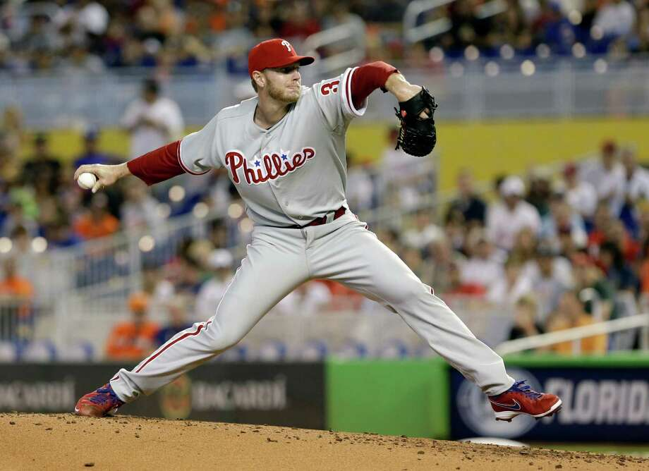 Roy Halladay joined Andy Pettitte (247 wins) as the majors' only active 200-game winners by beating the Marlins on Sunday. The Braves' Tim Hudson is at 199. Photo: Alan Diaz, STF / AP
