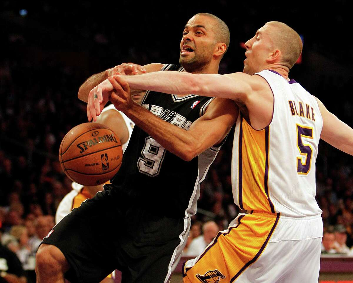 Steve Blake (5), who had 23 points to take up some of the scoring slack for the Kobe Bryant-less Lakers, strips the ball from the Spurs' Tony Parker.