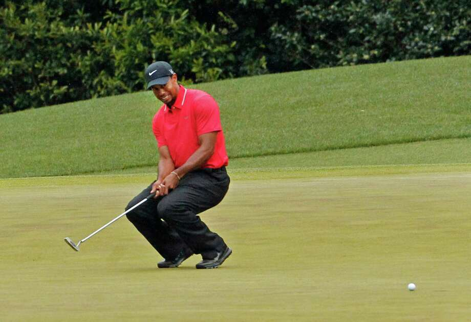 Hoping to get off to a good start and put pressure on the leaders, Tiger Woods shot a 1-over 37 on the front nine, including a frustrating miss of a birdie putt on No. 4. Photo: Gerry Melendez, MBR / The State
