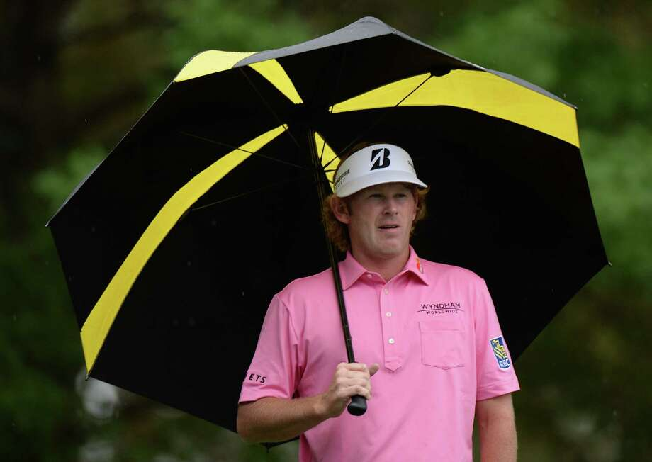 Brandt Snedeker of the US stands under an umbrella during the fourth round of the 77th Masters golf tournament at Augusta National Golf Club on April 14, 2013 in Augusta, Georgia.  AFP PHOTO / DON EMMERTDON EMMERT/AFP/Getty Images Photo: DON EMMERT, Staff / AFP