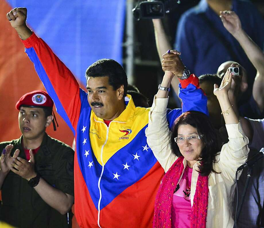 Nicolas Maduro celebrates the results with his wife, Cilia Flores. The vote was far closer than expected. Photo: Luis Acosta, AFP/Getty Images