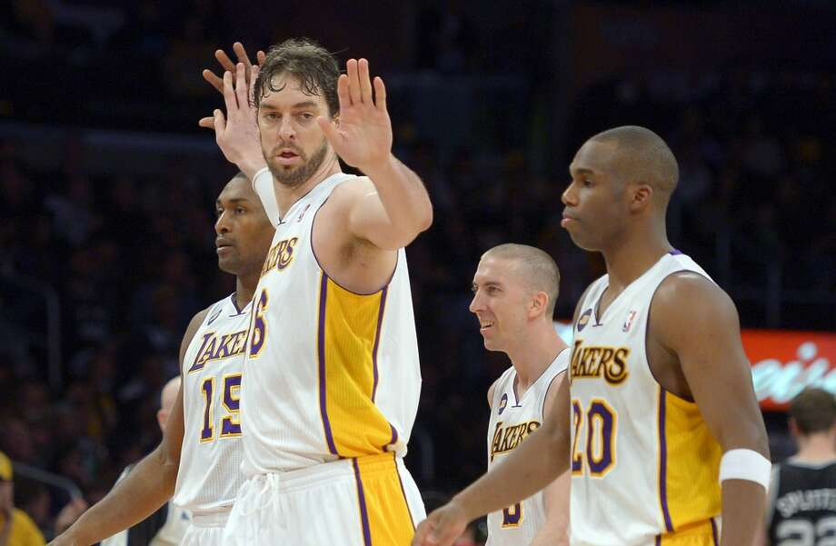 Los Angeles Lakers forward Pau Gasol (second from left) is congratulated by forward Metta World Peace (left) as guard Steve Blake (second from right) and guard Jodie Meeks look on during the second half  Sunday, April 14, 2013, in Los Angeles. The Lakers won 91-86.