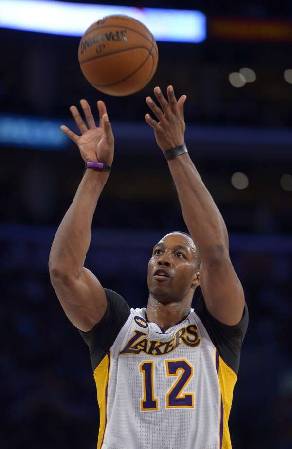 Los Angeles Lakers center Dwight Howard shoots a free throw during the second half against the Spurs, Sunday, April 14, 2013, in Los Angeles. The Lakers won 91-86.