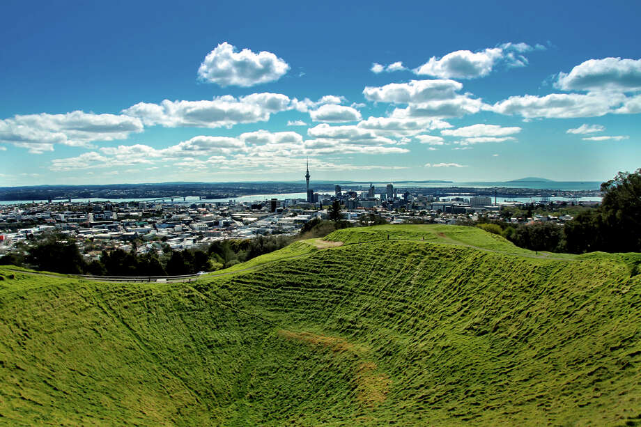 One round-trip ticket, coach class, from San Antonio to Auckland, New Zealand, on American Airlines (includes one checked bag)  PHOTO: A view from Auckland's Mt. Eden, showing the inside of a volcanic crater looking down towards the city's waterfront. Photo: Susan Blick, Flickr / Getty Images / Flickr RF